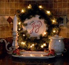 A wreath and a plate propped in a corner...great idea for Gram's wooden plate, O already put it in the kitchen anyway....cute!