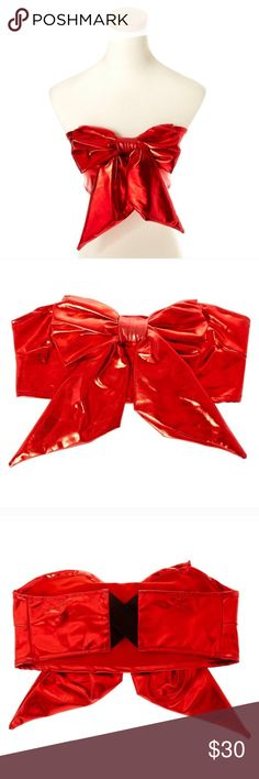 Metallic red bow tube top Rock around dressed like a pretty present wrapped up in a bright red bow! This Metallic Red Bow Tube Top is perfect for pairing with a fun Valentines colored tutu, some festive leggings, and more.  Metallic red color Large red bow embellishment Elastic cross stretch back Valentine's Day Tops