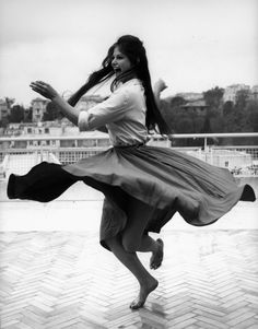 Claudia Cardinale dancing barefoot on a roof terrace in Rome, 1959.