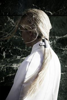 Bulldog clip as hair accessory.
