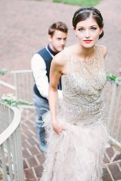 Sparkly wedding dress with gold details and feathered skirt by Sue Wong, hair and makeup by Blush Beauty and Makeup, image by Taken by Sarah Photography.