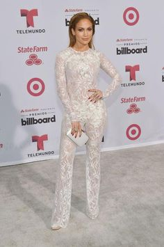 Jennifer Lopez in a white lace jumpsuit at the Billboard Latin Music Awards