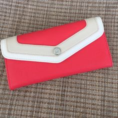 Coral Wallet By Grace Adele Brand new, no tags, but NEVER used. Perfect summer wallet  two cash slots, 11 card slots, and a zipper back for change. Grace Adele Bags Wallets