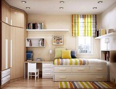 Small bedroom ideas for adding space: Drawers under bed which doubles as seating, extra wall shelves and a compact desk all on one wall