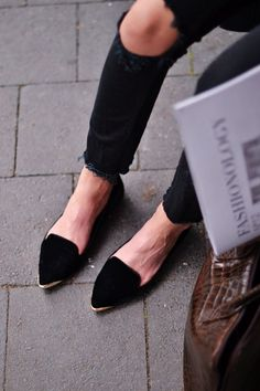 ripped jeans. pointy toe flat.