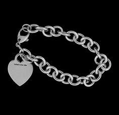 """TIFFANY & CO. HEART TAG CHARM BRACELET  Tiffany & Co. Sterling Silver Heart Tag Charm Bracelet.  Bracelet weighs   34 grams and measures 7.5"""" in length."""