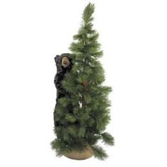 Natural looking potted scotch pine Christmas tree features an adora...
