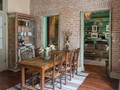 This New Orleans Home Blends Historic Charm With Creole Style.  By Sienna Fantozzi.  Dining Room: Designer Jensen Killen revealed to Lonny that a portion of the home's interior used to be a porch, so the wall that now separates the kitchen from the living room was at one time an exterior wall. Since the kitchen & dining space were once open to the outside, the designers decided to keep the room's porch-like feel by leaving the old window and ceiling beams exposed.  Sara Essex Bradley…