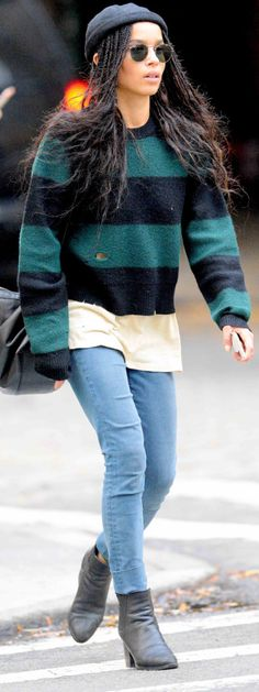 Zoë Kravitz goes for a walk in a ragged sweater in New York on Thursday.