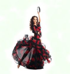 Spanish Gypsy dancing Flamenco with tambourine.