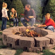 How to Build a Stone Fire Ring:  Build this backyard fire pit with retaining wall blocks...