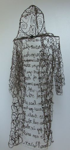 Orah Diemer. Freedom, Maine. US. Monks Robe Humble Fiber Art Icelandic Sheep's Wool with Thomas Merton Quote.  by InJoyEmporium, Etsy. Fusion of hand spinning, weaving and sewing. She hand spins the un-dyed wool from the fleece of an Icelandic Sheep named Nutmeg from Somerville, Maine.