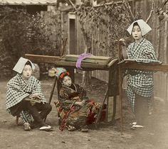 """A very similar carte-de-visite identifies the woman seated on the left as Kayo, who was a popular geiko (geisha) in the Gion district of Kyoto during the 1870s. She and another geiko are both dressed as kago-ya (palanquin bearers), with a kamuro (child attendant for a Tayuu or Japanese Courtesan) sitting in the middle.""""  Text and image via Blue Ruin 1 on Flickr"""