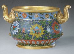 Elephant eared cloisonne lotus flowers and leaves incense burner. Notice the glassy green and sky blue colored enamels.