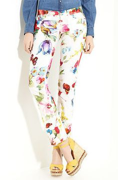 Dolce and Gabbana FLoral Print Pants style these floral cotton pants with icy blue peep toe pumps, bright yellow clutch along with a white Kimono top Wear it along with a Solid colored blazer in hot pink or orange along with a choker style pearl necklace. the look is perfect for a luxurious afternoon shopping.  available for $396