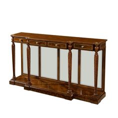 A fine rosewood veneered console or serving table, the reeded edge breakfront top with rounded corners, crossbanded in rosewood and with flowerhead roundels to the corners, above four brass mounted an Fine Furniture, Antique Furniture, Modern Furniture, Furniture Decor, Outdoor Furniture, Beveled Edge Mirror, America Furniture, Theodore Alexander, Living Room Furniture Arrangement