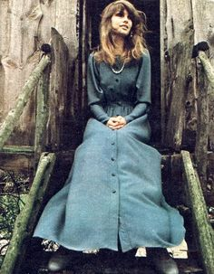 Jean Shrimpton wearing a dress by Janice Wainwright at her parents' farm in Buckinghamshire, 1973. Photo by Jeanloup Sieff.