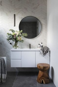 A modern ensuite, with marble look chevron tiles and concrete look floors. Round mirror, free standing bath, floating vanity and gunmetal tap wear. Photography by Hcreations. Bathroom Mirror Design, Modern Bathroom Design, Bathroom Interior Design, Small Bathroom, Bathroom Showers, Bathroom Ideas, Bath Design, Funky Bathroom, Tile Design