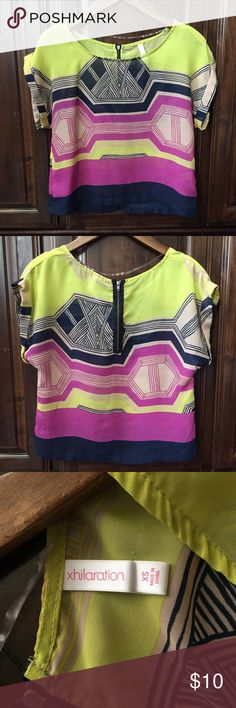 Xhilaration Neon Top size XS Xhilaration Neon Top size XS. Gently worn top that is still in great condition. Sheer material, in the model picture worn with a black tank. Xhilaration Tops Blouses