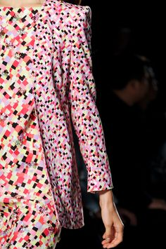 Mila Schön at Milan Fashion Week Spring 2013. Love the two different sizes of print of textile.