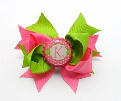 Initial bottle cap hair bow.   Any initial available $6.50( mom buy this for the baby it already has her initial)
