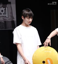 The balloon hits him in the face, poor Kookie