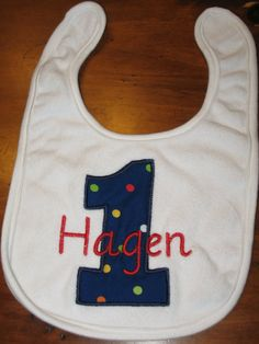 Baby bib monogram using organic quilted fabric with personalise babies name in embroidery