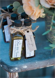 Small bottles of olive oil and flavored vinegar make perfect wedding favors at a rustic wedding