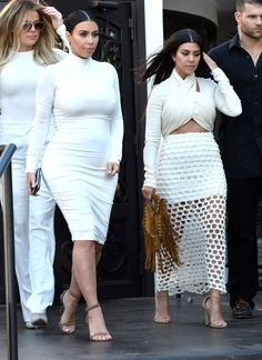 Kim Kardashian out in all white with Kourtney and Khloe Kardashian in Thousand Oaks, California. See all of her best looks.