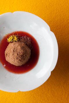 A dessert of chocolate Nougatknödel, a sweet Austrian dumpling, with raspberry sauce at the Biohotel Schwanen in Bizau.