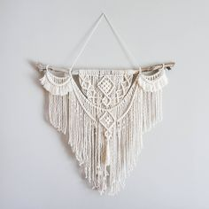 Large Macrame Wall hanging  A fusion knots and of course lots of fringing! The star of this piece is a beautiful long branch.  Your piece is made by hand using natural unbleached cotton and revived branches from local woods in Upstate NY and the Adirondacks. ✨✨✨  SIZING She measures roughly 35in x 35in (from where the nail will be to longest rope on macrame), so she is sure to stand out wherever you choose to hang her.  Sizing is approximate: Branch Width - 35 Macrame Length - 28 Rope…