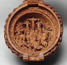 Rosary Bead, early 16th century  South Netherlandish (Brabant)  Boxwood  Diam. 2 1/16 in. (5.2 cm). In the lower half is the Crucifixion with ancillary scenes of the Agony in the Garden and Peter cutting off the ear of Malchus.