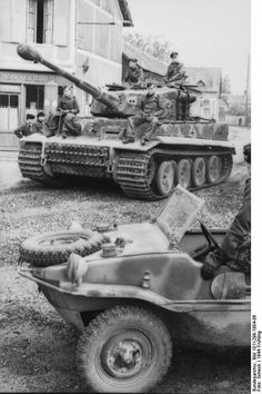 Tiger I heavy tank of the German 1st SS Division Leibstandarte SS Adolf Hitler and Schwimmwagen vehicle in a village in Northern France, spring 1944  Photographer     Scheck  Source     German Federal Archive