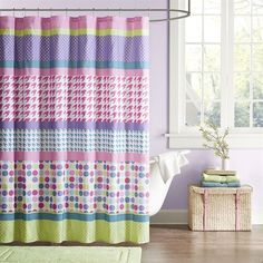 The Mi Zone Katie Shower Curtain brings eclectic fun to your space. Its printed design show off oversized polka dots, stripes, hounds tooth and small polka dots in a bright color palette.