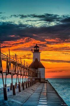 """Great Lakes Michigan lighthouse - Winning """"Pure Michigan Moment"""" - of the St. Joseph North Pier Lighthouse - will appear in the 2013 Pure Michigan Travel Guide. Beautiful Sunset, Beautiful World, Beautiful Places, House Beautiful, St Joseph Lighthouse, Lighthouse Art, Michigan Travel, Lake Michigan, Michigan Usa"""
