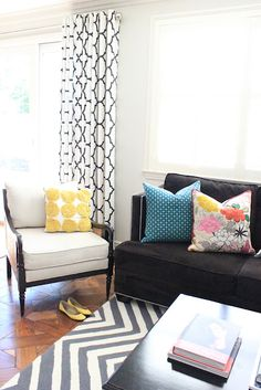 I love everything about this space, from the bright pillows to the bold patterns!