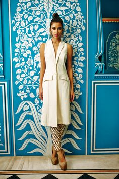 An elegant cream tailored jacket paired with embroidered cigarette pants.
