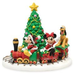 """Department 56 Mickey's Village Mickey's Holiday Express Collectible Figurine """"All aboard! Mickey, Minnie & Pluto ride the Holiday Express choo-choo train all the way to Christmas in this adorable Mickey's Village figurine by Department Disney Christmas Village, Disney Christmas Decorations, Disney World Christmas, Mickey Christmas, Christmas Party Games, Christmas Villages, Christmas Activities, Christmas Ideas, Christmas Tree"""