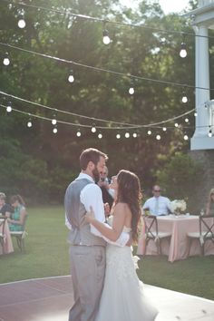 Globe lights are traditional wedding lighting. These drop edison bulbs look wonderful hanging above the first dance of this wedding reception. See all our drop globe lights here: http://www.lightsforalloccasions.com/nsearch.aspx?keywords=drop