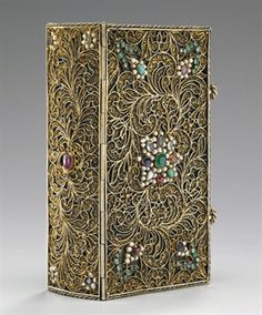 17th Century Gold filigree bound book - perhaps Augsburg. 11.8cms x 6.8cms - Christies 6 Dec 2008.
