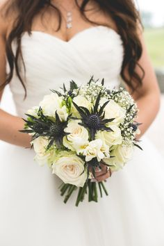 Thistle, White Roses and Baby's Breath bouquet