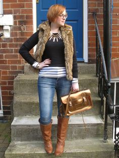 Love a fur vest with jeans and boots. Casual awesomeness.