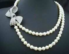 pearls/single strand joined by a pin, cute idea!