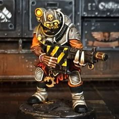 The genestealer cultists of the planetoid Hermes of the Trismagistus the III System that mine the upper levels of the rock are able to blend seemlessly into human society, this character hides a grotesquely hideous face under a special mask.  #neophytehybrids #genestealercults #mining #frodohammers #PaintingWarhammer