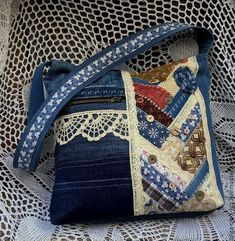 nice mix of denim, lace, ribbon and quilt panel./ patchwork denim bag with buttons and lace / Buy Bag Gone With the Wind.The fun of piecing my denim pieces together to create this bagThis Pin was discovered by Ann Patchwork Denim, Patchwork Bags, Quilted Bag, Crazy Patchwork, Patchwork Patterns, Fabric Patterns, Denim Handbags, Denim Tote Bags, Denim Purse