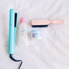 Can't live without my straightener good ole petroleum jelly detangling spray and my trusty hairbrush to tame the frizz