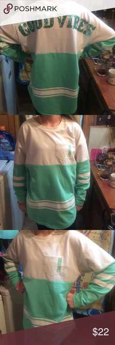 """Rue 21 Long sleeve """"GOOD VIBES"""" shirt Very stylish. Nice to wear with tights or leggings. Sparkly sequins on the back with the words GOOD VIBES. ALSO says GOOD VIBES on front left pocket Rue21 Tops"""