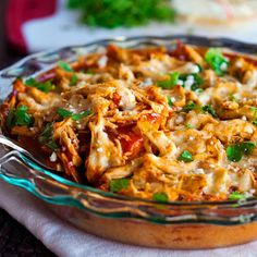 This chicken tamale pie is a huge crowd pleaser and so easy to make! A corn cake bottom layer topped with shredded chicken, enchilada sauce, and cheese.   pinchofyum.com