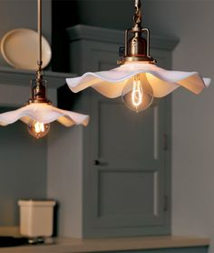 The George. A pair of pendant fixtures with Opal scalloped reflector shades and carbon filament bulbs.