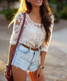 White lace shirt, shorts, long brown hair, brown belt, red bag